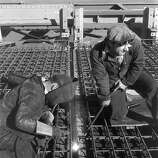 Workers welding the rebar before the roadway concrete was poured. for  the Golden Gate Bridge.