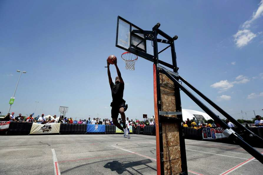 Marcus Jackson attempts a slam dunk during the slam dunk competition  on the main court, Saturday, M