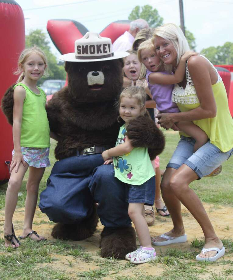"The Kountze Volunteer Fire Department held their first annual ""Fun Day"" at the Central Station on Pine Street on Saturday, May 19. Attendees enjoyed bar-b-que, live entertainment, rides, laser tag, a live auction, and a dunking booth. Smokey the Bear even made a special guest appearance. Photo: David Lisenby, HCN_KVFD"