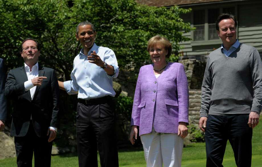French President Francois Hollande, left, answers a question with President Barack Obama along with German Chancellor Angela Merkel and British Prime Minister David Cameron, right during a photo opportunity at the G-8 Summit Saturday, May 19, 2012 at Camp David, Md. Photo: AP