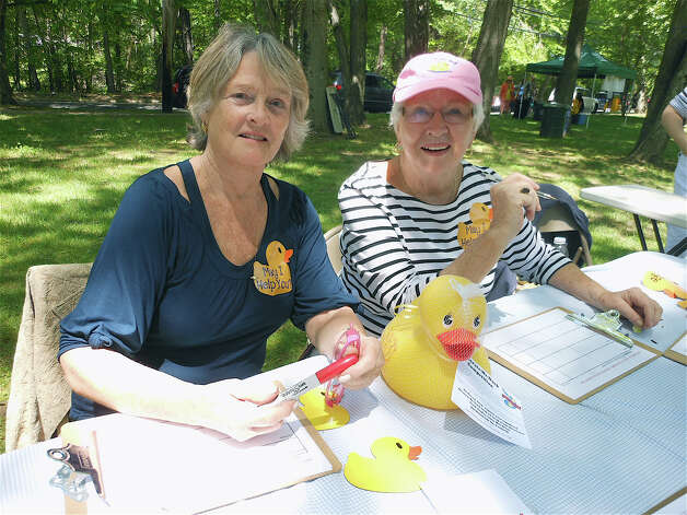 Christine Herman and Kay Luff, with St. Catherine's Academy, at the Duckie Derby on Saturday. Photo: Mike Lauterborn / Fairfield Citizen contributed