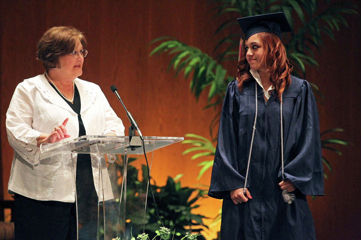 METRO Janice Thompson commends Larissa Robles for a 100 percent attendance record from Kindergarten on as Christian Heritage School holds graduation ceremonies at MacArthur Park Church of Christ on May 19, 2012. Tom Reel/ San Antonio Express-News