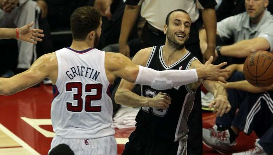 San Antonio Spurs Manu Ginobili (20) pass the ball as Los Angeles Clippers Blake Griffin (32) reaches out to bock him during the second half of game three of the Western Conference semifinals at Staples Center in Los Angeles, Saturday, May 19, 2012.  Jerry Lara/San Antonio Express-News (Jerry Lara / San Antonio Express-News)