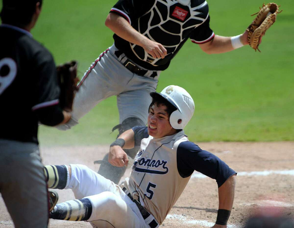 Mark Ecker (5) of O'Connor reacts after scoring against Churchill during Class 5A third-round baseball playoffs action at Wolff Stadium on Saturday, May 19, 2012. Billy Calzada / San Antonio Express-News