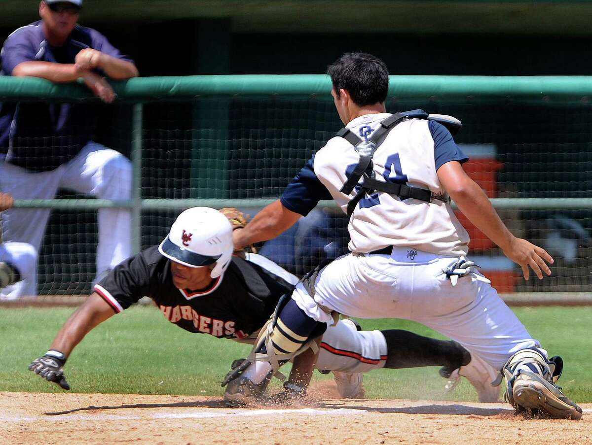 Churchill runner Dimitri Flowers is tagged out by O'Connor catcher Justin Garcia during the second game of their Class 5A third-round baseball doubleheader at Wolff Stadium on Saturday, May 19, 2012. Billy Calzada / San Antonio Express-News