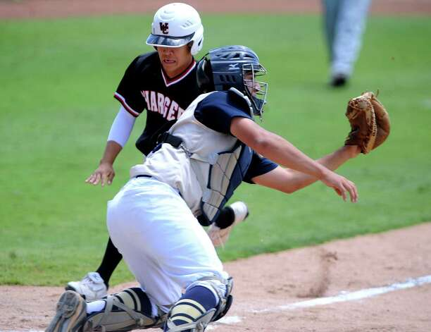O'Connor catcher Justin Garcia reaches for the throw as Churchill runner Josh Uriegas runs by him to score during the second game of their Class 5A third-round baseball doubleheader at Wolff Stadium on Saturday, May 19, 2012. Billy Calzada / San Antonio Express-News Photo: BILLY CALZADA, Express-News / SAN ANTONIO EXPRESS-NEWS