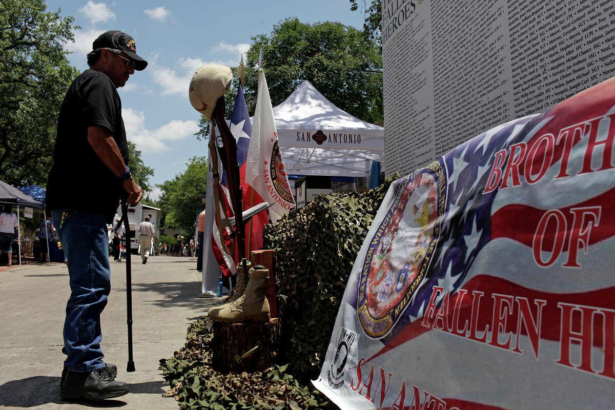 Vietnam veteran Danny Bernal (Marine) with the Brothers of Fallen Heroes, makes sure theTexas Fallen Heroes Memorial Wall is ready for display at La Villita in San Antonio on Saturday, May 19, 2012.