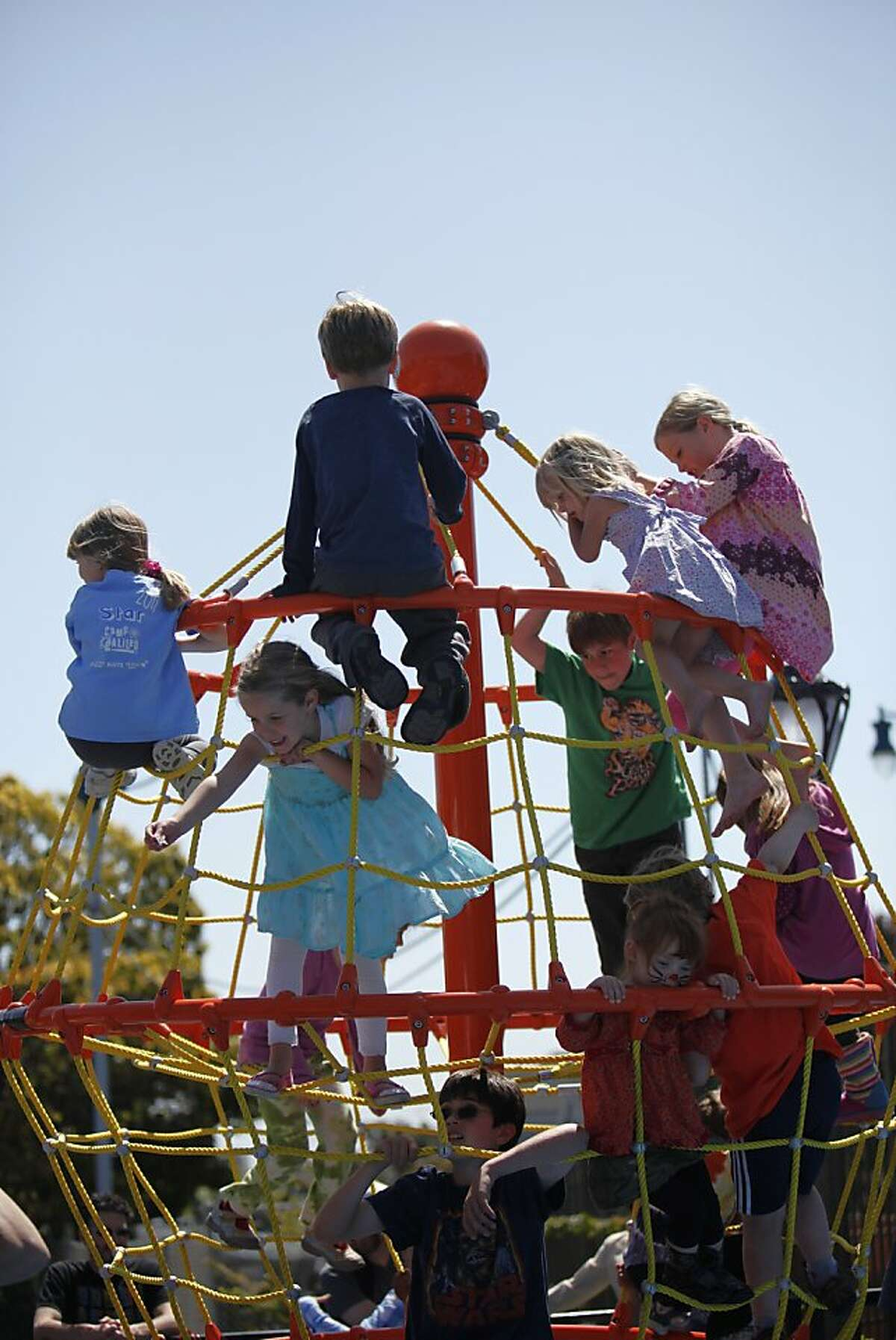 Children play on the new playground structure during