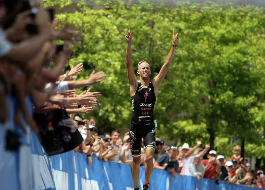 The crowd cheers Jordan Rapp before crossing the finish line to win the Memorial Hermann Ironman Texas triathlon Saturday, May 19, 2012, in The Woodlands. Photo: James Nielsen, Chronicle / © Houston Chronicle 2012
