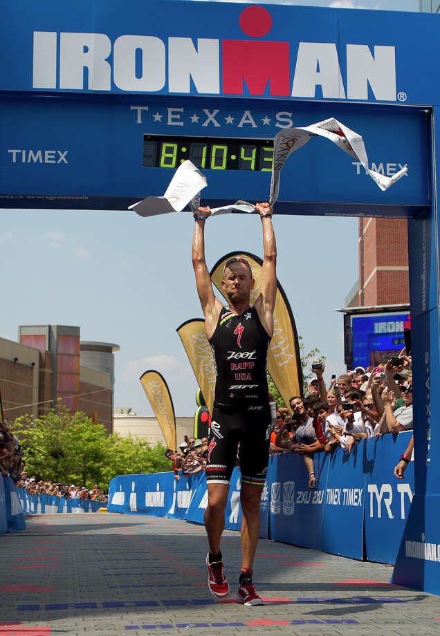 Jordan Rapp celebrates at the finish line after winning the Memorial Hermann Ironman Texas triathlon Saturday, May 19, 2012, in The Woodlands. Photo: James Nielsen, Chronicle / © Houston Chronicle 2012