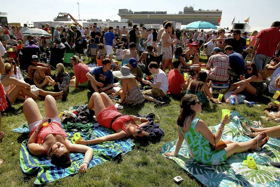 Race fans enjoy the infield during the 137th Preakness Stakes at Pimlico Race Course on May 19, 2012