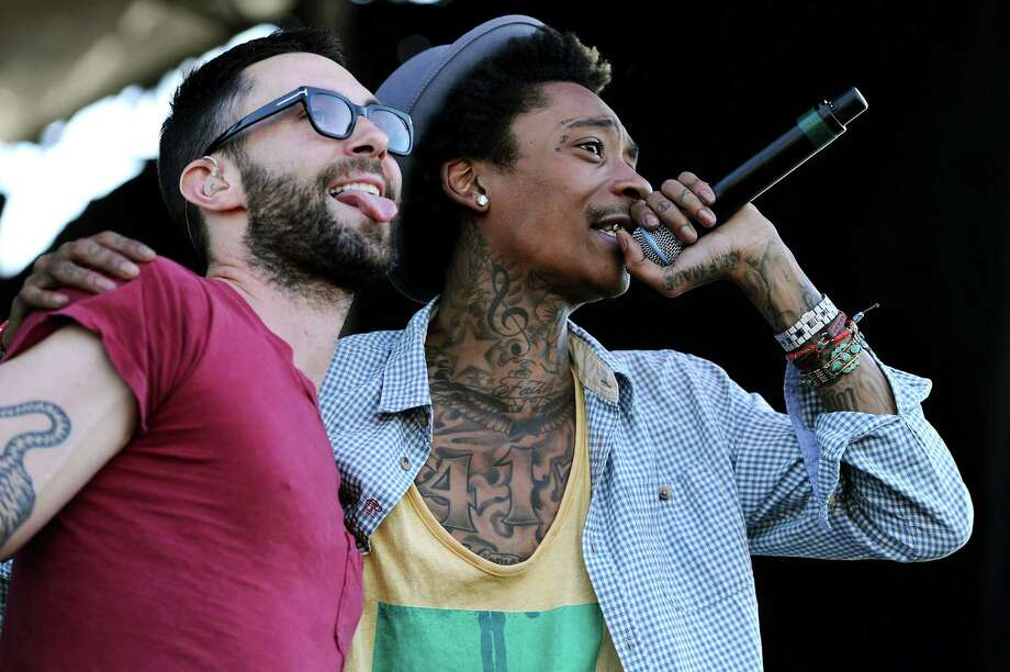 Performing artist Wiz Khalifa (R) sings a song with Maroon 5 lead vocalist and guitarist Adam Levine prior to the 137th running of the Preakness Stakes at Pimlico Race Course on May 19, 2012 in Baltimore, Maryland. Photo: Patrick Smith, Getty Images / 2012 Getty Images