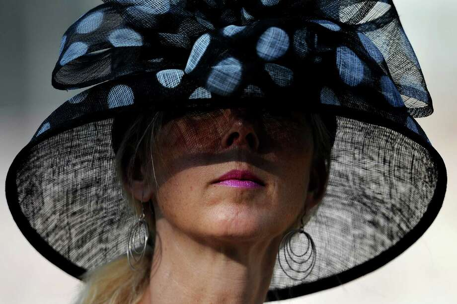 A woman looks on before the 137th running of the Preakness Stakes at Pimlico Race Course on May 19, 2012 in Baltimore, Maryland. Photo: Patrick Smith, Getty Images / 2012 Getty Images