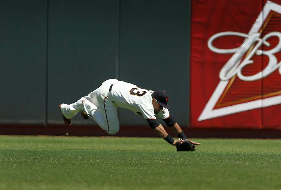 Melky Cabrera hangs on to a low fly ball from Jemile Weeks in the 1st inning of the Giants 4-0 win over the Oakland A's at AT&T Park in San Francisco, Calif. on Saturday, May 19, 2012. Photo: Paul Chinn, The Chronicle