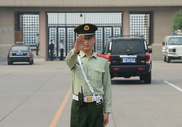 A Chinese paramilitary blocks access to the old VIP terminal where blind rights activist Chen Guangcheng was believed to be after leaving the Chaoyang Hospital in Beijing on May 19, 2012. Blind Chinese activist Chen Guangcheng said on May 19 he was at Beijing's international airport with his family and that he believed he would be flying to New York. AFP PHOTO / Mark RALSTONMARK RALSTON/AFP/GettyImages Photo: Mark Ralston, AFP/Getty Images