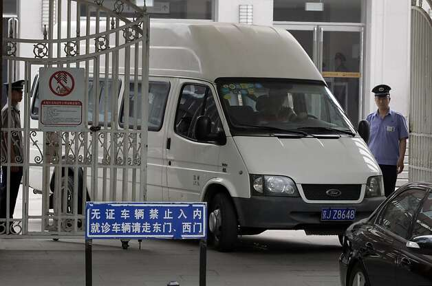 A van with covered windows leaves in a convoy under a tight security from the hospital where blind activist lawyer Chen Guangcheng was  recuperating in Beijing, China, Saturday, May 19, 2012. Chen Guangcheng told The Associated Press Saturday that he is now at the Beijing airport after leaving hospital. (AP Photo/Ng Han Guan) Photo: Ng Han Guan, Associated Press