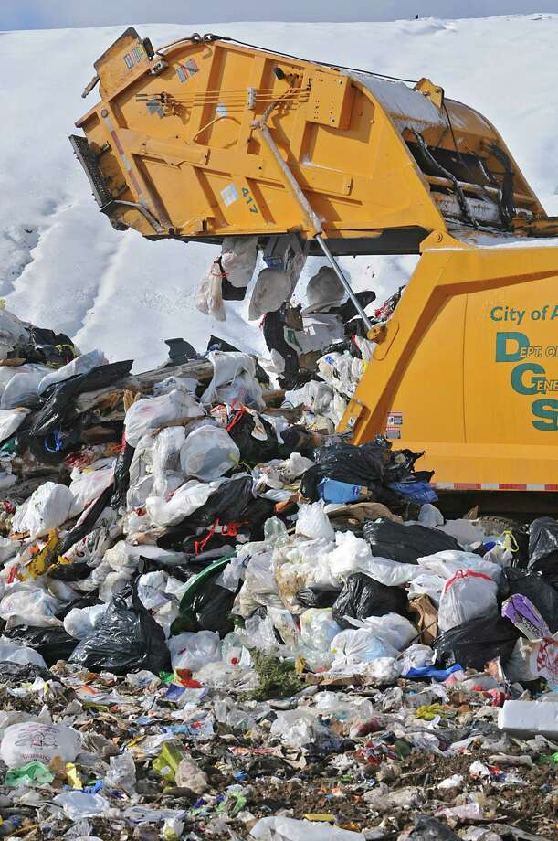A garbage truck empties its contents at the Rapp Road Landfill in Albany in 2011. Momentum for a trash authority that could encompass several counties appears to have waned.(Lori Van Buren / Times Union) Photo: Lori Van Buren / 00011806A