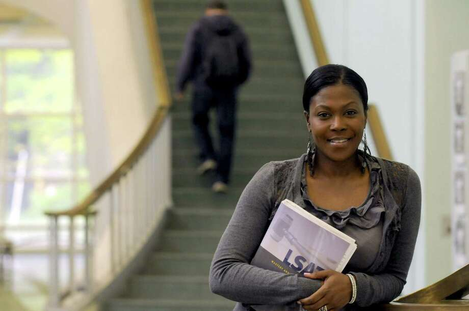 Joevonne Brace was at mother 16 and again at 18. Now 41, she's graduating from UAlbany with a bachelor's degree in English and is heading to law school next fall in Albany N.Y. Tuesday May 15, 2012. (Michael P. Farrell/Times Union) Photo: Michael P. Farrell