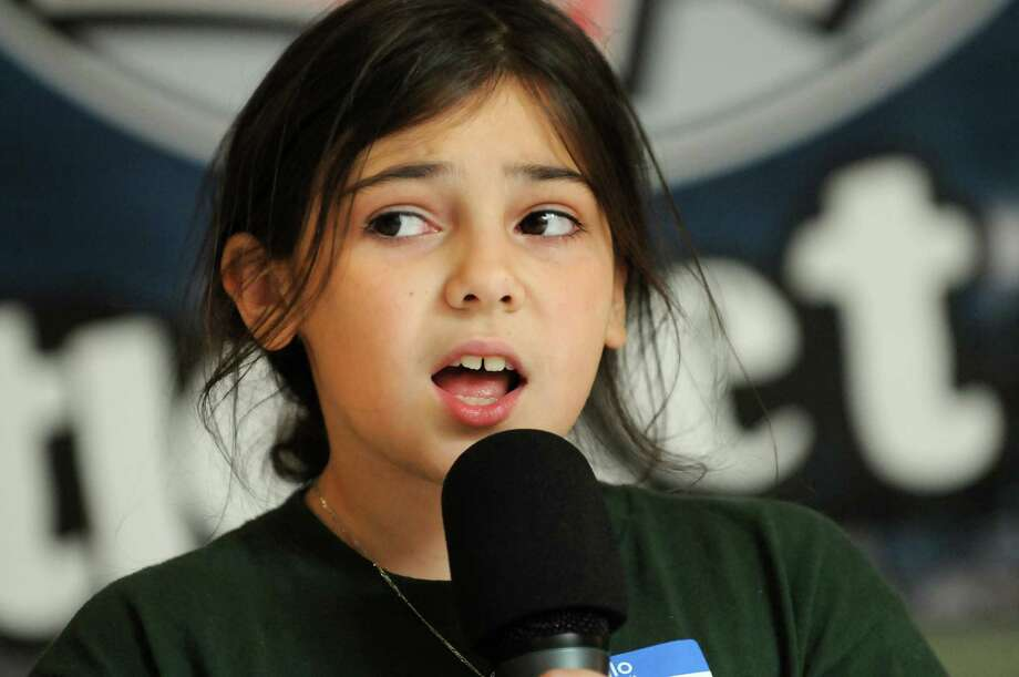 Ariana Romeo-Mullin, 9, of Troy sings the Star Spangled Banner during the 2nd Annual National Anthem tryouts for the Tri-City ValleyCats 2012 baseball season on Saturday, May 19, 2012, at Crossgates Mall in Guilderland, N.Y. (Cindy Schultz / Times Union) Photo: Cindy Schultz / 00017358A