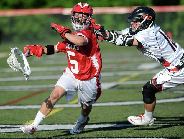 Greenwich's William Waesche controls the ball as he is defended by New Canaan's Patrick Burke during Saturday's FCIAC boys lacrosse quarterfinal game at New Canaan High School on May 19, 2012. Photo: Lindsay Niegelberg / Stamford Advocate