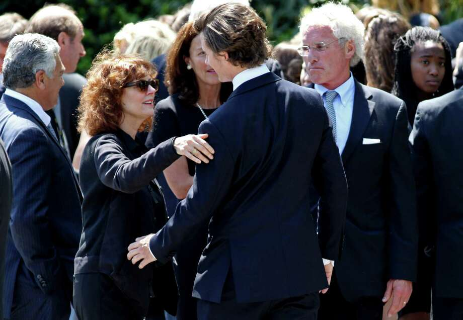 Actress Susan Sarandon, second from left, reaches out to hug a member of the Kennedy family after the funeral of Mary Richardson Kennedy, the estranged wife of Robert F. Kennedy Jr., at St. Patrick's Church in Bedford, N.Y., Saturday, May 19, 2012. Kennedy was found dead of an apparent suicide this week at her home in Bedford. Joseph P. Kennedy II stands just right of center. (AP Photo/Craig Ruttle) Photo: Craig Ruttle, Associated Press / FR61802 AP