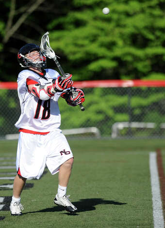 New Canaan's Puck Richardson controls the ball during Saturday's FCIAC boys lacrosse quarterfinal game against Greenwich at New Canaan High School on May 19, 2012. Photo: Lindsay Niegelberg / Stamford Advocate