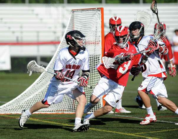 New Canaan's Puck Richardson controls the ball as he is defended by Greenwich's Jack Nail during Saturday's FCIAC boys lacrosse quarterfinal game at New Canaan High School on May 19, 2012. Photo: Lindsay Niegelberg / Stamford Advocate