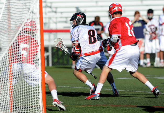 New Canaan's Michael Bossidy controls the ball during Saturday's FCIAC boys lacrosse quarterfinal game against Greenwich at New Canaan High School on May 19, 2012. Photo: Lindsay Niegelberg / Stamford Advocate