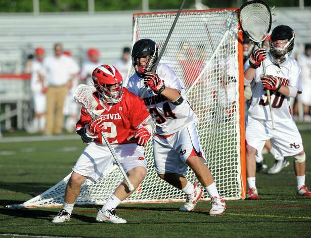 Greenwich's Will Gibian controls the ball as he is defended by New Canaan's Kevin McDonough during Saturday's FCIAC boys lacrosse quarterfinal game at New Canaan High School on May 19, 2012. Photo: Lindsay Niegelberg / Stamford Advocate