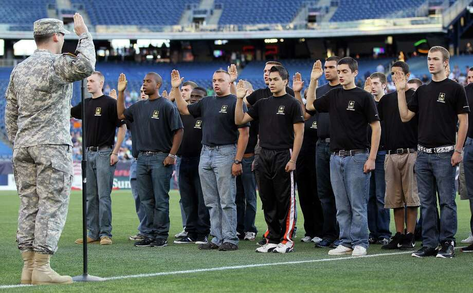 FOXBORO, MA - MAY 19:  To celebrate Military Appreciation Night, future soldiers are sworn in during a pregame ceremony before the New England Revolution take on the Houston Dynamo on May 19, 2012 at Gillette Stadium in Foxboro, Massachusetts. Photo: Elsa, Getty Images / 2012 Getty Images