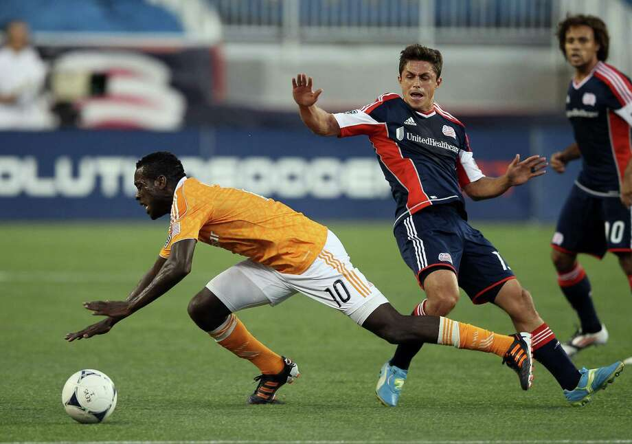 FOXBORO, MA - MAY 19:  Je-Vaughn Watson #10 of the Houston Dynamo and Ryan Guy #13 of the New England Revolution   on May 19, 2012 at Gillette Stadium in Foxboro, Massachusetts. Photo: Elsa, Getty Images / 2012 Getty Images