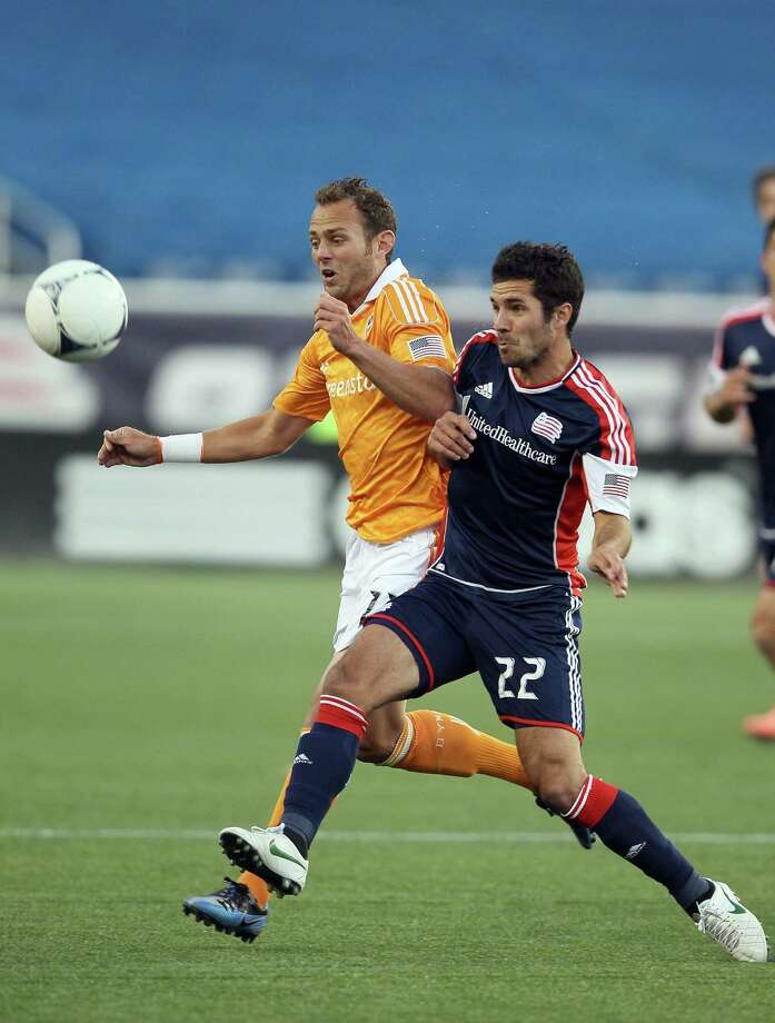 FOXBORO, MA - MAY 19:  Brad Davis #11 of the Houston Dynamo and Benny Feilhaber #22 of the New England Revolution fight for the ball in the first half on May 19, 2012 at Gillette Stadium in Foxboro, Massachusetts. Photo: Elsa, Getty Images / 2012 Getty Images