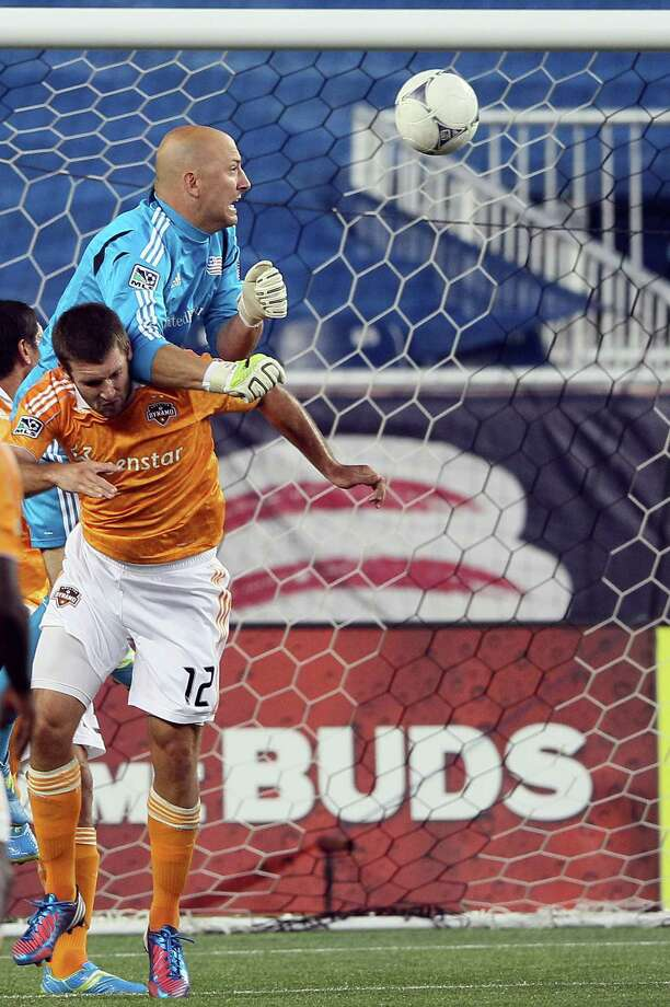 FOXBORO, MA - MAY 19:  Will Bruin #12 of the Houston Dynamo gets the ball past Matt Reis #1 of the New England Revolution   on May 19, 2012 at Gillette Stadium in Foxboro, Massachusetts. Photo: Elsa, Getty Images / 2012 Getty Images