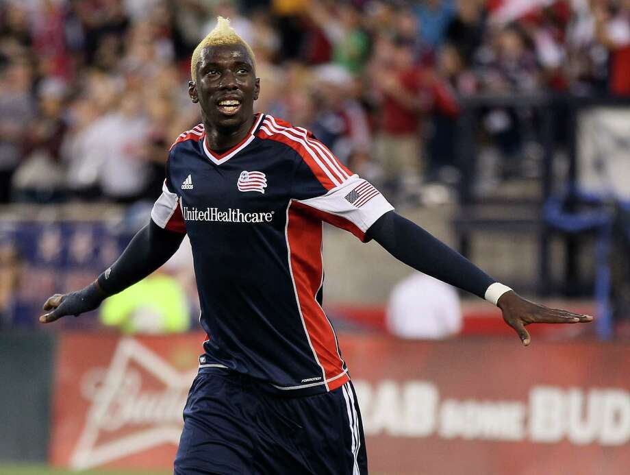 FOXBORO, MA - MAY 19:  Saer Sene #39 of the New England Revolution celebrates his goal against the Houston Dynamo on May 19, 2012 at Gillette Stadium in Foxboro, Massachusetts. Photo: Elsa, Getty Images / 2012 Getty Images