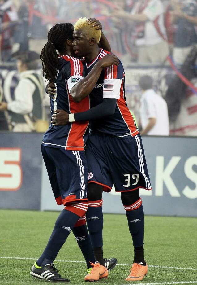 FOXBORO, MA - MAY 19:  Saer Sene #39 of the New England Revolution is congratulated by teammate Shalrie Joseph #21 after Sene scored a goal against the Houston Dynamo on May 19, 2012 at Gillette Stadium in Foxboro, Massachusetts. Photo: Elsa, Getty Images / 2012 Getty Images