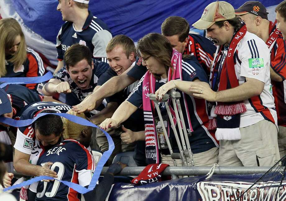 FOXBORO, MA - MAY 19:  Saer Sene #39 of the New England Revolution celebrates his goal with the fans in the first half against the Houston Dynamo on May 19, 2012 at Gillette Stadium in Foxboro, Massachusetts. Photo: Elsa, Getty Images / 2012 Getty Images