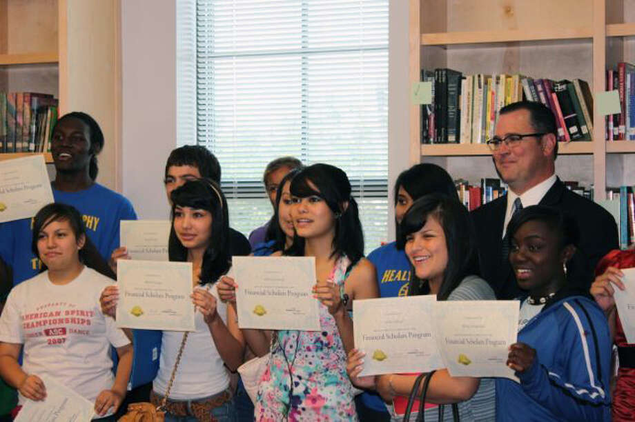 Some of the 33 Healy-Murphy students who completed an online financial literacy course hold their certificates Friday May 19, 2012 in the new library at the school. Photo: COURTESY / COURTESY OF HEALY-MURPHY