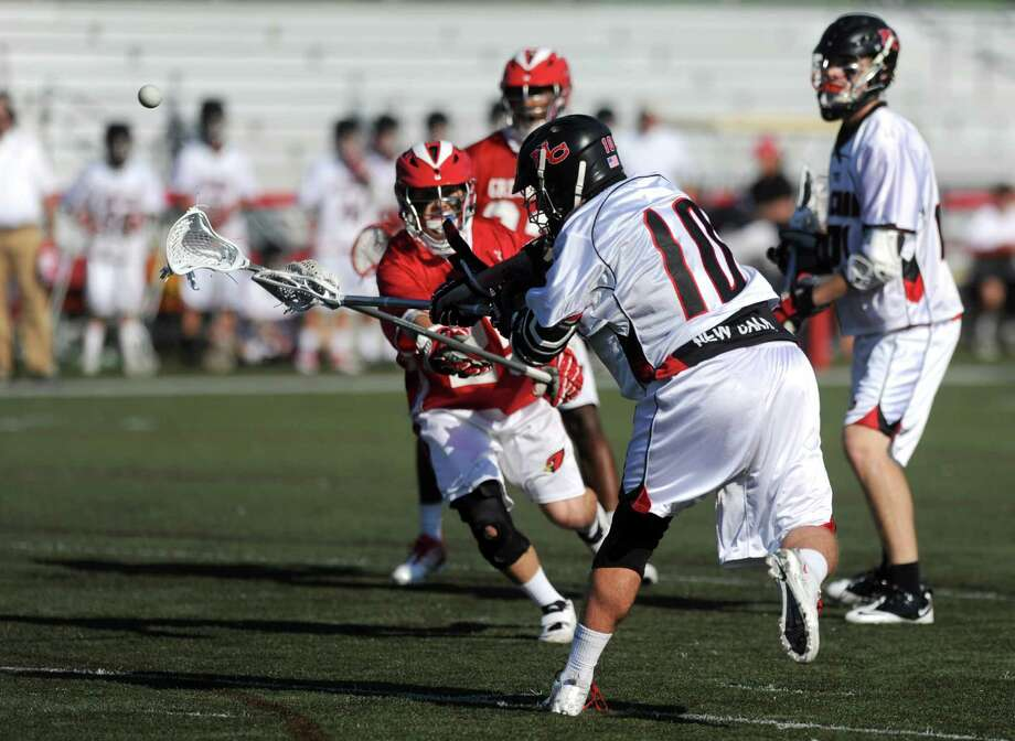 New Canaan's Peter Kraus scores a goal during Saturday's FCIAC boys lacrosse quarterfinal game at New Canaan High School on May 19, 2012. Photo: Lindsay Niegelberg / Stamford Advocate