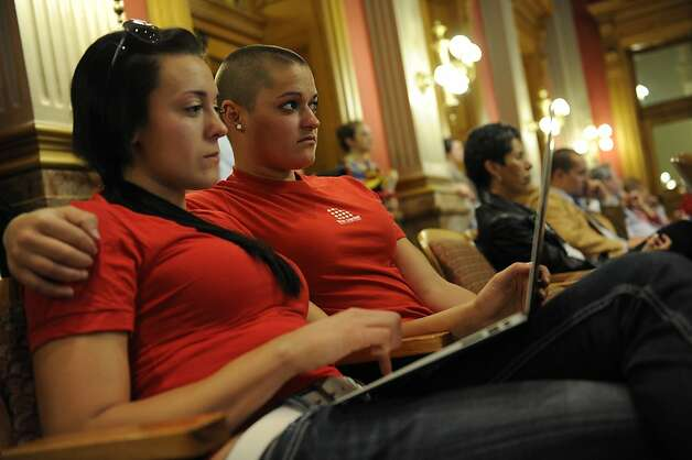 Mandalyn Starkovich, left, and Kristen Marshall wait for a hearing on Senate Bill 2 to come up in front of the House Judiciary Committee at the State Capitol in Denver, Thursday, May 3, 2012. The Colorado Civil Union Act recently passed the Senate with bipartisan support. The bill would allow same sex couple to enter into civil union. (AP Photo/The Denver Post, Craig F. Walker)  MAGS OUT; TV OUT; INTERNET OUT Photo: Craig F. Walker, Associated Press