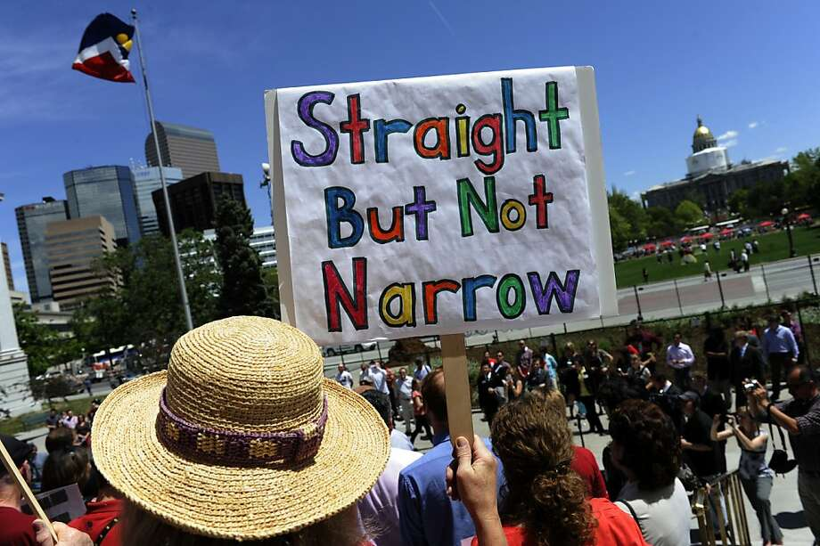 "Ann Ogg, of Littleton, carries a sign during a rally supporting civil unions at the Denver City and County Building in Denver, Thursday, May 3, 2012. Ogg said she was there to support her lesbian daughter. She said, ""it's absolutely crazy that the GLBT population does not enjoy the same rights the rest of us enjoy."" The rally took place prior to the House Judiciary Committee hearing on Senate Bill 2 at the State Capitol. The Colorado Civil Union Act recently passed the Senate with bipartisan support. The bill would allow same sex couple to enter into civil union.  (AP Photo/The Denver Post, Craig F. Walker)  MAGS OUT; TV OUT; INTERNET OUT Photo: Craig F. Walker, Associated Press"