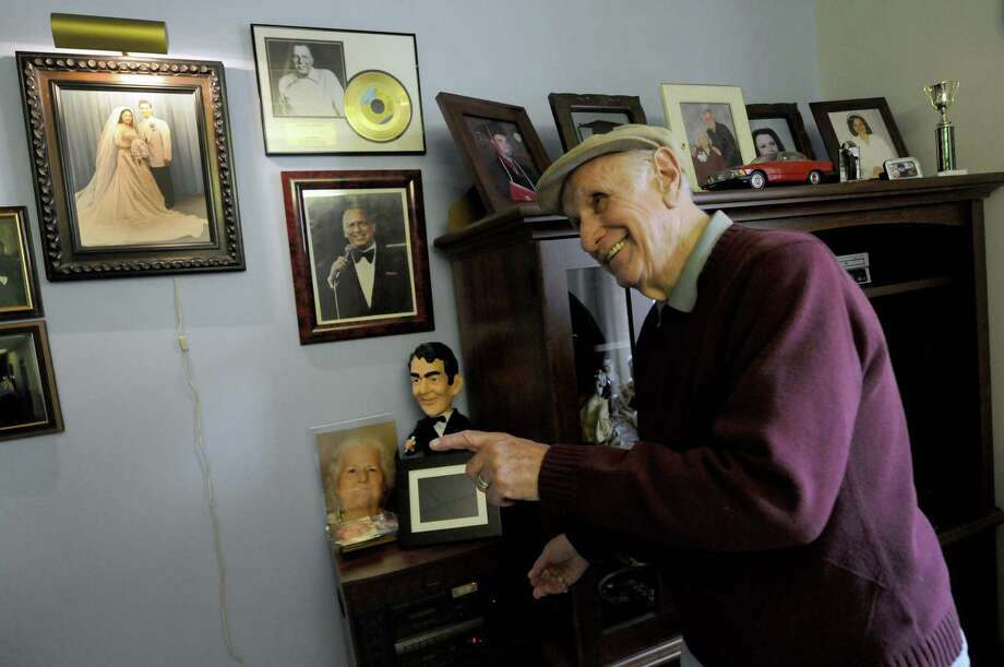 Maplewood Manor resident Jimmy Granitto plats a recording of him singing a Frank Sinatra  in his room at the home in Ballston Spa N.Y. Wednesday April 25, 2012. (Michael P. Farrell/Times Union) Photo: Michael P. Farrell
