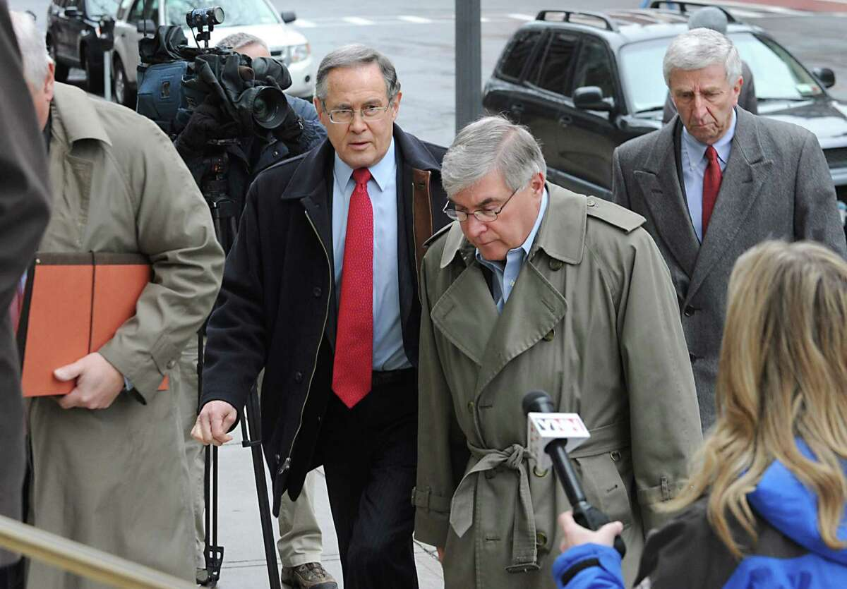 Timothy McGinn, center, and David Smith, right, arrive at the U.S. District Courthouse Friday, Jan. 27, 2012 in Albany, N.Y., with their attorneys William Dreyer, left, and E. Stewart Jones, center left. (Lori Van Buren / Times Union)