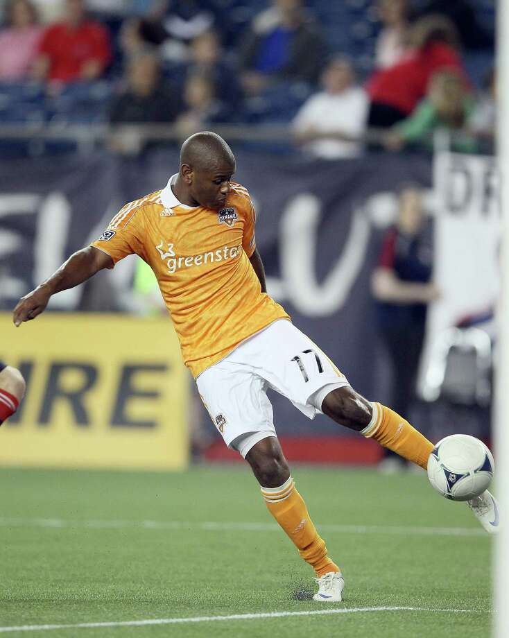 FOXBORO, MA - MAY 19: Luiz Camargo #17 of the Houston Dynamo scores a goal in the second half agianst the New England Revolution on May 19, 2012 at Gillette Stadium in Foxboro, Massachusetts.The New England Revolution and the Houston Dynamo tied 2-2. Photo: Elsa, Getty Images / 2012 Getty Images