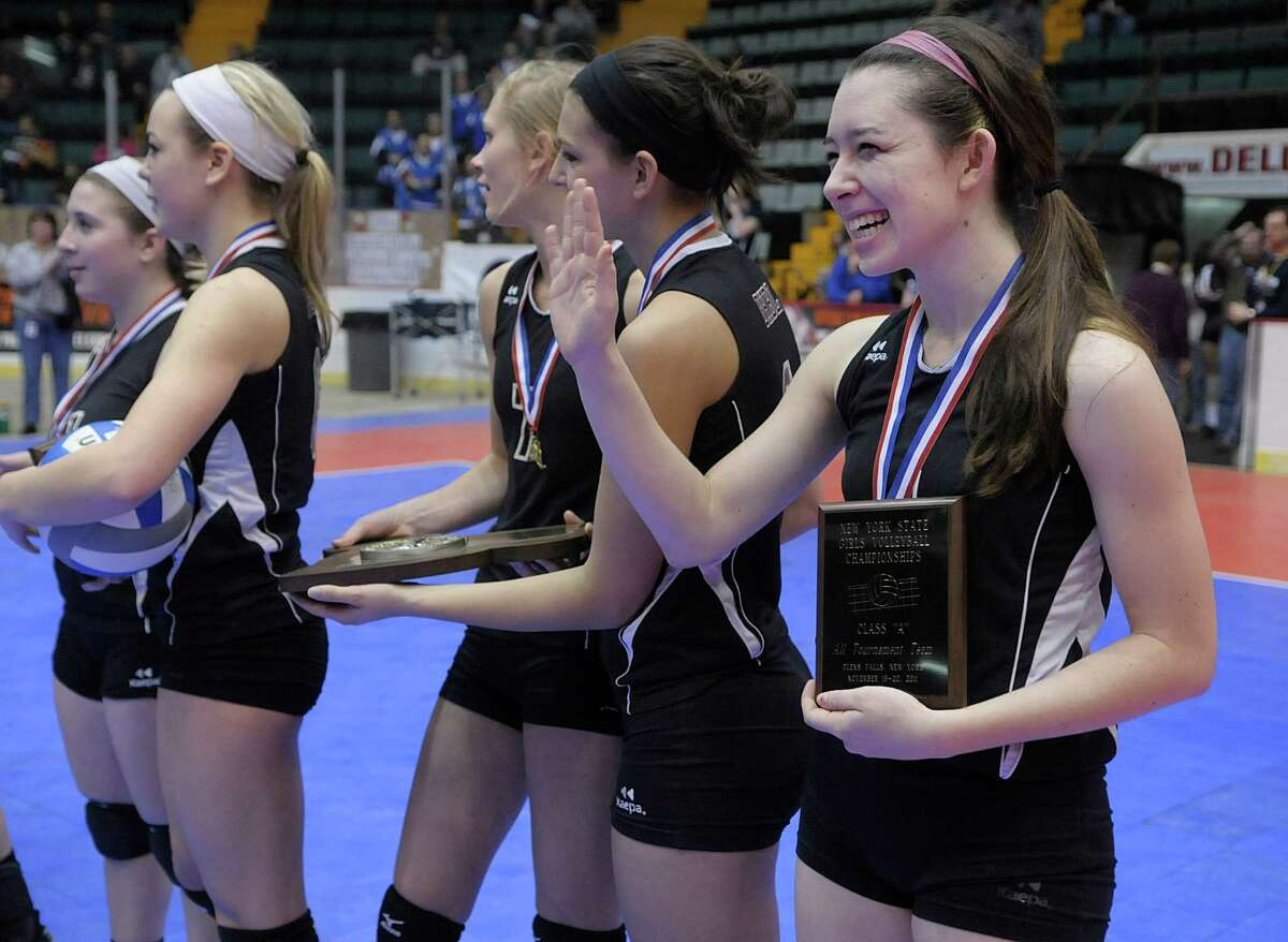 Natalie Ziskin, right, of Burnt Hills-Ballston Lake waves to family and friends in the stands after receiving her medal and plaque following their State championship match against Mercy at the Glens Falls Civic Center on Sunday, Nov. 20, 2011 in Glens Falls, NY. Burnt Hills-Ballston Lake won to become state champions in Class A girls' volleyball. (Paul Buckowski / Times Union)