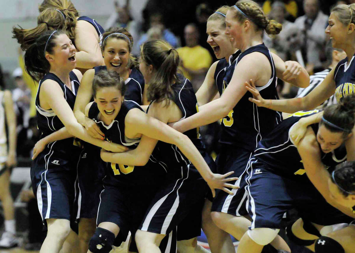 The Averill Park Girls basketball team celebrates after defeating Lakeland 53-46 in the girls class A state high school basketball finals at Hudson Valley Community College in Troy,New York 03/20/2010. (Michael P. Farrell/Times Union)