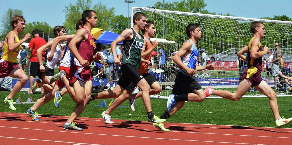 Start of the boys mile at the Eddy Meet at Schenectady High School Saturday May 19, 2012.   (John Ca