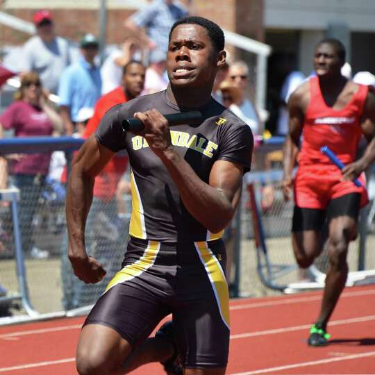 Uniondale's Tresean Goodwin, left, crosses the finish line first in a 4 x 1 relay at the Eddy Meet a