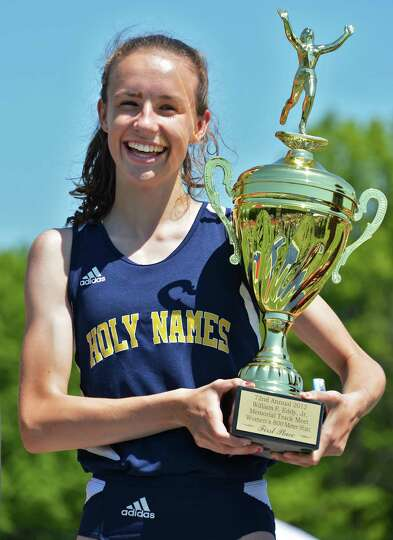 Holy Names' Leah Triller on the podium with the trophy for the girls' 800m at the Eddy Meet at Schen