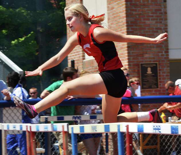 Guilderland's Lea Cure takes first in a 400m hurdle heat at the Eddy Meet at Schenectady High School