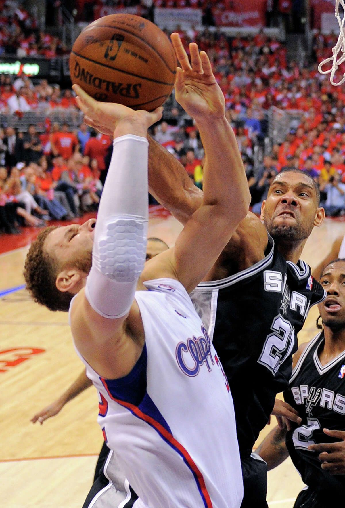 The Spurs' Tim Duncan, right, finished with three blocks, including this stuff of a Blake Griffin shot.